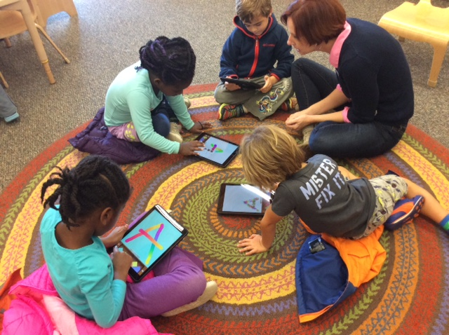young students using tablets to learn