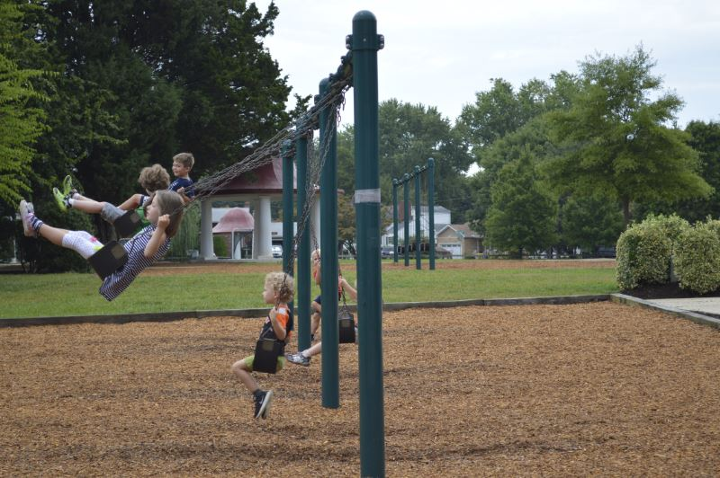 students playing on swings