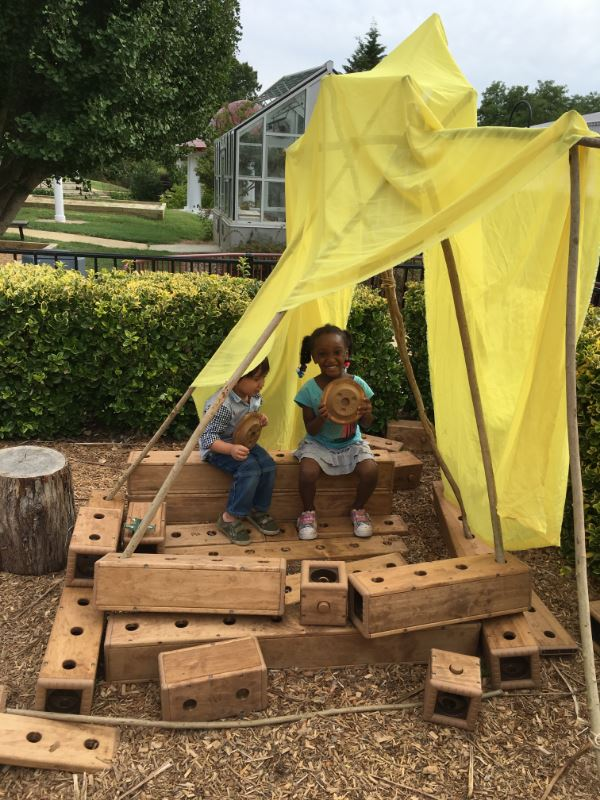 students building fort outside