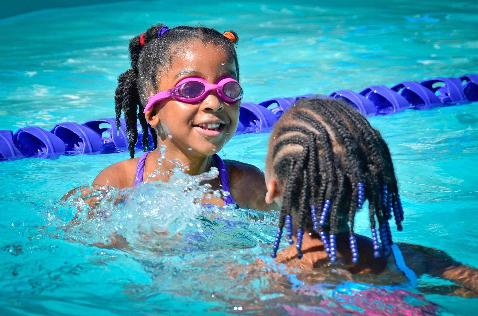 girls swimming at summer camp